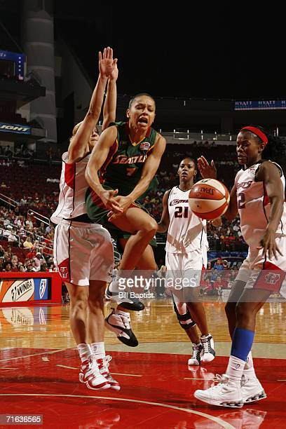 Anastasia Kostaki of the Houston Comets blocks a shot by Betty Lennox of the Seattle Storm during the game on August 12 2006 at the Toyota Center in...