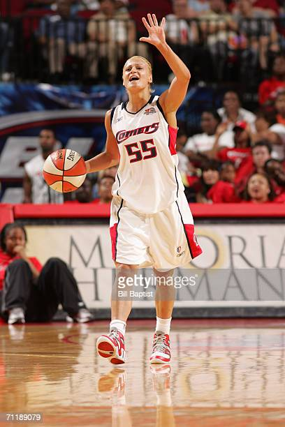 Anastasia Kostaki of the Houston Comets calls a play as she moves the ball up court during a game against the San Antonio Silver Stars at the Toyota...