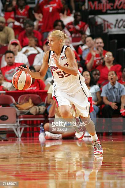 Anastasia Kostaki of the Houston Comets drives the ball up court during a game against the San Antonio Silver Stars at the Toyota Center on May 21...