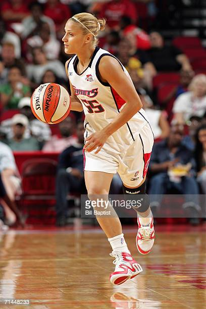 Anastasia Kostaki of the Houston Comets moves the ball up court during a game against the Minnesota Lynx at the Toyota Center on June 4 2006 in...
