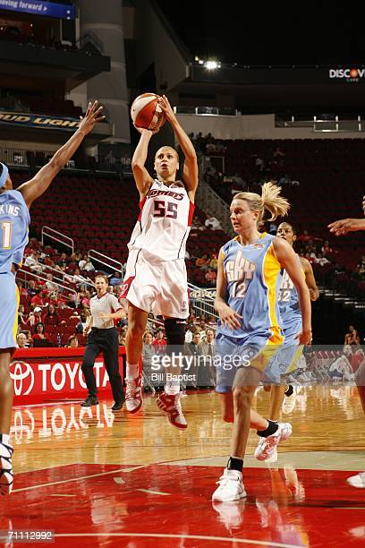 Anastasia Kostaki of the Houston Comets shoots between Jia Perkins and Stacey Dales of the Chicago Sky on June 2 2006 at the Toyota Center in Houston...