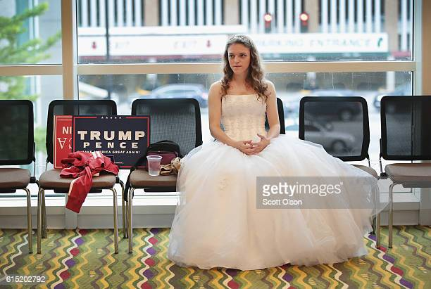 Anastasia Lee waits for the start of a campaign rally with Republican presidential nominee Donald Trump at the KI Convention Center on October 17...