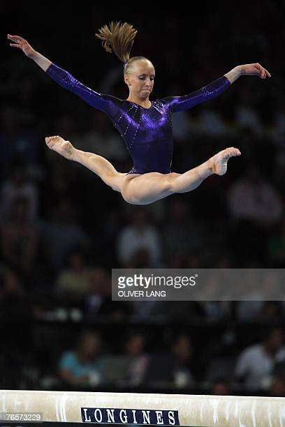 Anastasia Liukin of the US competes on the beam during the women's individual all-around final of the 40th World Artistic Gymnastics Championships 07...