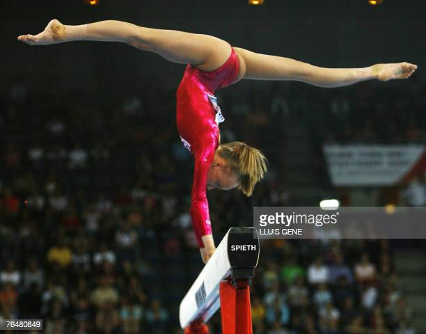 Anastasia Liukin of the US performs on the beam during the women's qualifications of the 40th World Artistic Gymnastics Championships 02 September...