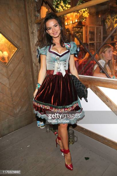 Anastasia Matthaeus wearing a Dirndl by Lola Paltinger during the Almauftrieb as part of the Oktoberfest 2019 at Kaefer Tent at Theresienwiese on...