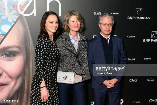 "Anastasia Mikova, Olga Bonnafé and General Director of BNP Paribas Jean-Laurent Bonnafé attend the ""Woman"" Premiere At UGC Normandie on March 03,..."