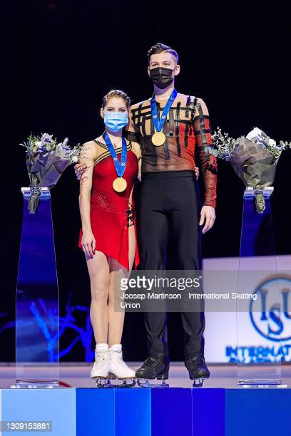 Anastasia Mishina and Aleksandr Galliamov of FSR pose in the Pairs medal ceremony during day two of the the ISU World Figure Skating Championships at...