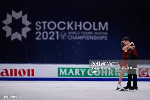 Anastasia Mishina and Aleksandr Galliamov of FSR react in the Pairs Free Skating during day two of the the ISU World Figure Skating Championships at...