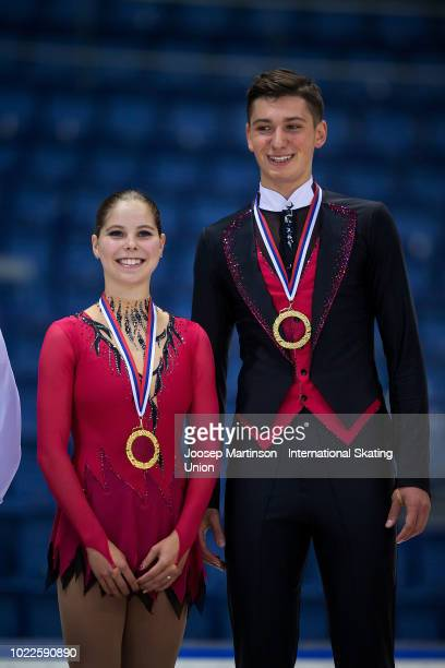 Anastasia Mishina and Aleksandr Galliamov of Russia pose in the Junior Pairs medal ceremony during the ISU Junior Grand Prix of Figure Skating at...