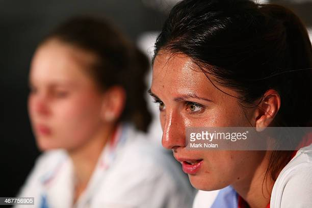Anastasia Myskina and Veronica Kudermetova of Russia talk to the media after the singles match against Samantha Stosur of Australia during the Fed...