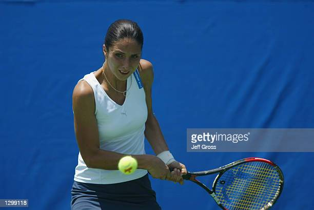 Anastasia Myskina hits a backhand shot against Francesca Schiavone during the Acura Classic on July 30 2002 at the La Costa Resort and Spa in...