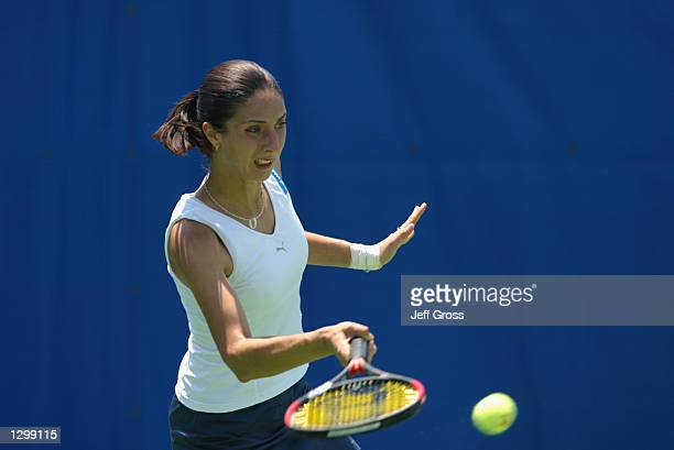 Anastasia Myskina hits a forehand shot against Francesca Schiavone during the Acura Classic on July 30 2002 at the La Costa Resort and Spa in...