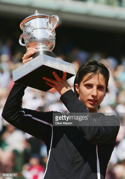 Anastasia Myskina of Russia celebrates with the trophy after winning her womens final match against Elena Dementieva of Russia during Day Thirteen of...