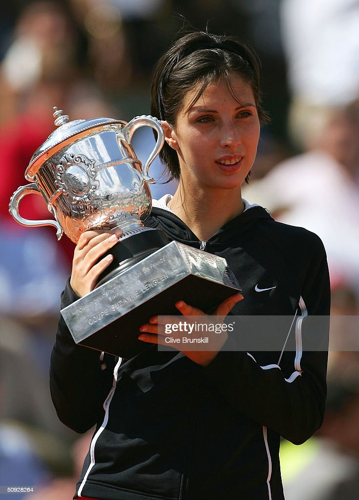 Anastasia Myskina of Russia celebrates with the trophy after winning her womens final match against Elena Dementieva of Russia during Day Thirteen of the 2004 French Open Tennis Championship at Roland Garros on June 5, 2004 in Paris, France.