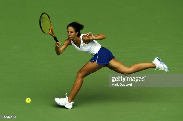 Anastasia Myskina of Russia hits a forehand to Chanda Rubin of the USA during day eight of the Australian Open Grand Slam at Melbourne Park January...