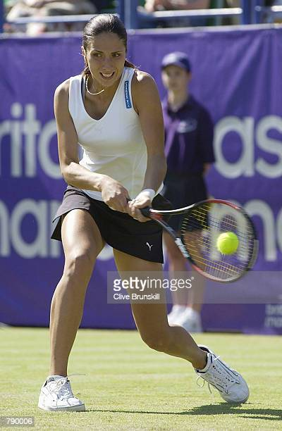 Anastasia Myskina of Russia in action against Anne Kremer of Luxemberg during the quarter final of the ladies singles in the Britannic Asset...