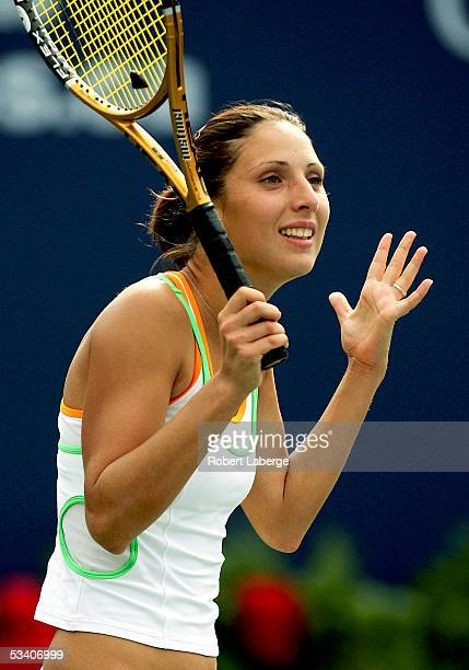 Anastasia Myskina of Russia looks at her coach after defeating Shinobu Asagoe of Japan 76 75 in the third round of the Sony Ericsson WTA Tour Rogers...