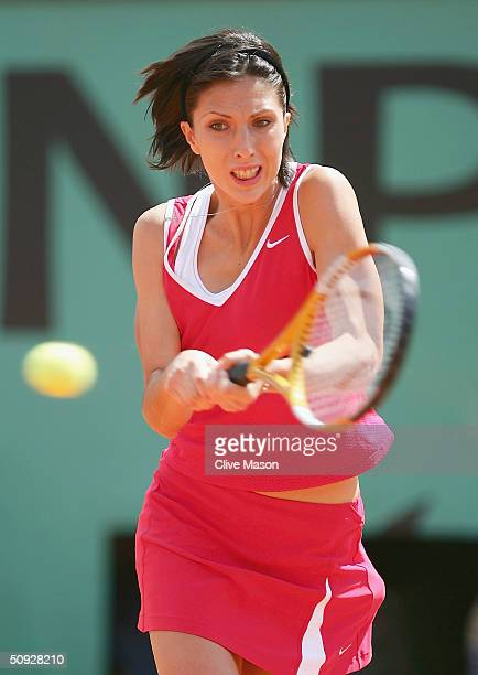 Anastasia Myskina of Russia plays a return during her womens final match against Elena Dementieva of Russia on Day Thirteen of the 2004 French Open...
