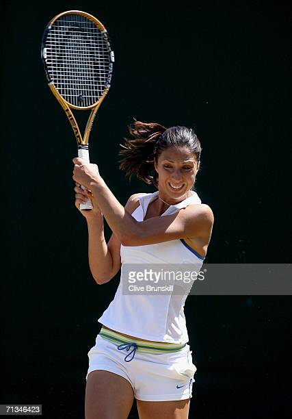 Anastasia Myskina of Russia returns a backhand to Anabel Medina Garrigues of Spain during day six of the Wimbledon Lawn Tennis Championships at the...