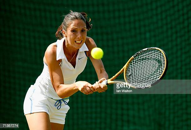Anastasia Myskina of Russia returns a backhand to Jelena Jankovic of Serbia and Montenegro during day seven of the Wimbledon Lawn Tennis...