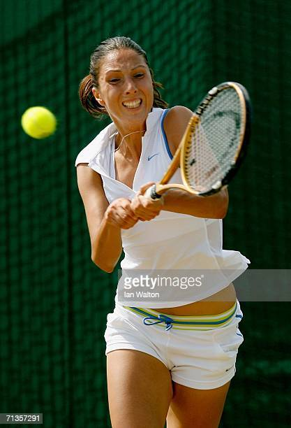 Anastasia Myskina of Russia returns a forehand to Jelena Jankovic of Serbia and Montenegro during day seven of the Wimbledon Lawn Tennis...
