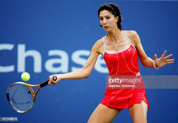 Anastasia Myskina of Russia returns a shot to Ludmila Cervanova of Slovakia during the US Open August 31 2004 at the USTA National Tennis Center in...