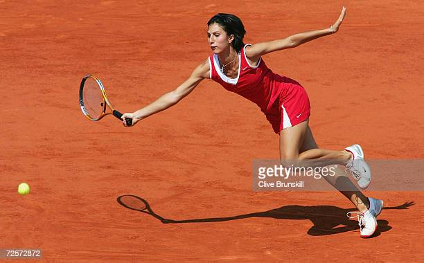 Anastasia Myskina of Russia returns in her womens final match against Elena Dementieva of Russia during Day Thirteen of the 2004 French Open Tennis...