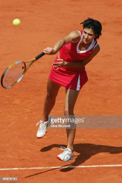 Anastasia Myskina of Russia serves in her womens final match against Elena Dementieva of Russia during Day Thirteen of the 2004 French Open Tennis...
