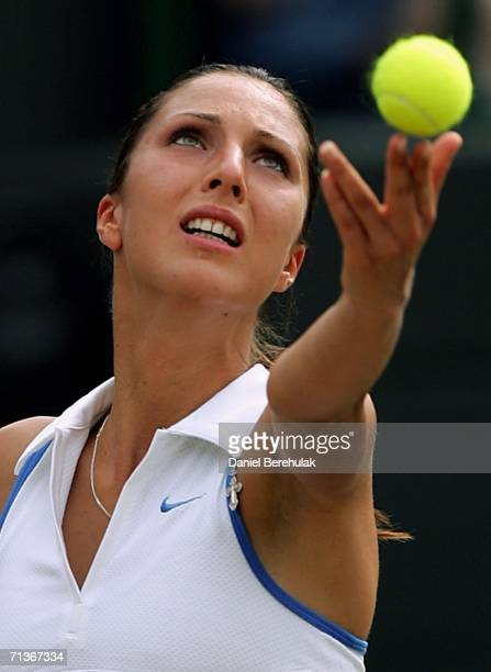 Anastasia Myskina of Russia serves to Amelie Mauresmo of France during day eight of the Wimbledon Lawn Tennis Championships at the All England Lawn...