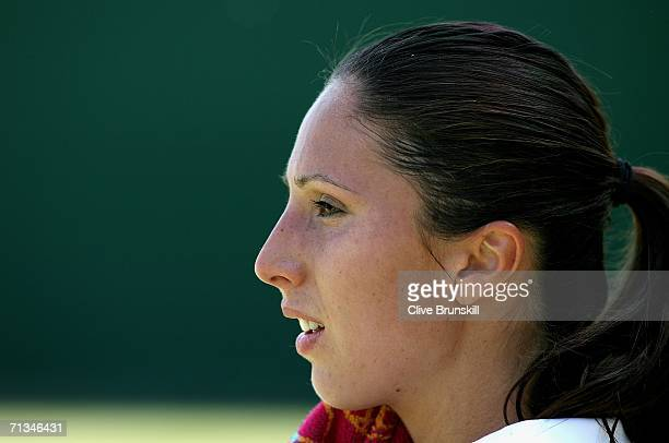Anastasia Myskina of Russia takes a seat between games in her match against Anabel Medina Garrigues of Spain during day six of the Wimbledon Lawn...