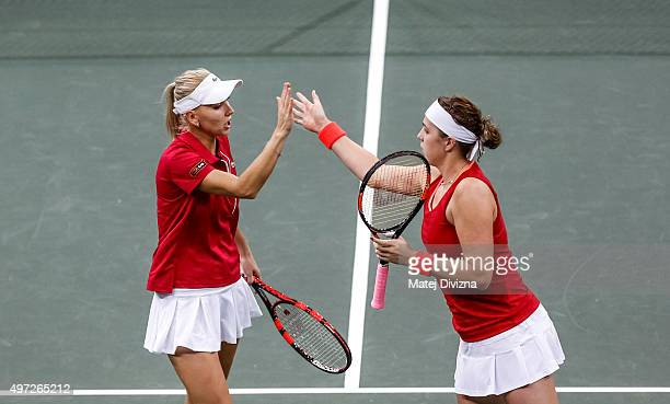 Anastasia Pavlyuchenkova and Elena Vesnina of Russia react against Karolina Pliskova and Barbora Strycova of Czech Republic during day two of the Fed...