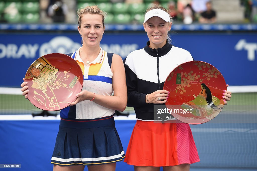 Anastasia Pavlyuchenkova of Russia and Caroline Wozniacki of Denmark pose during the trophy presentation after Wozniacki defeated Pavlyuchenkova in the women's singles final match on day seven of the Toray Pan Pacific Open Tennis At Ariake Coliseum on September 24, 2017 in Tokyo, Japan.
