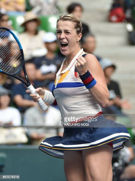 Anastasia Pavlyuchenkova of Russia celebrates her win over Angelique Kerber of Germany following their women's singles semifinal match at the Pan...