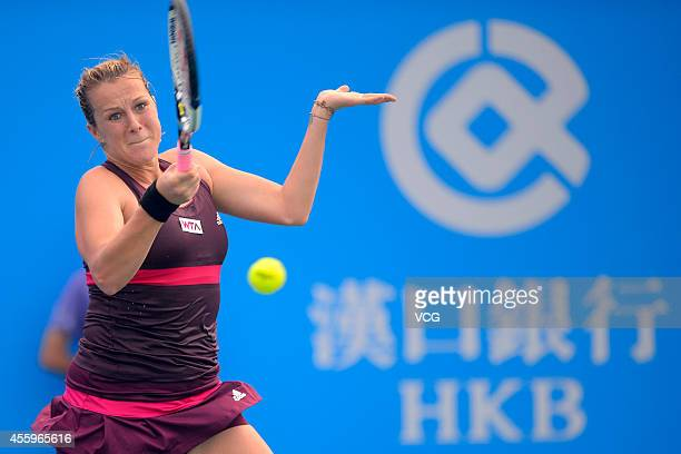 Anastasia Pavlyuchenkova of Russia competes with Casey Dellacqua of Australia during day three of the 2014 Dongfeng Motor Wuhan Open at Optics Valley...