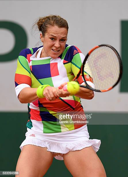Anastasia Pavlyuchenkova of Russia hits a backhand during the Ladies Singles first round match against Sara Sorribes Tormo of Spain on day one of the...