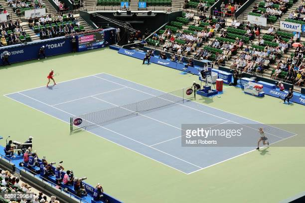 Anastasia Pavlyuchenkova of Russia plays a backhand against Caroline Wozniacki of Denmark during the women's singles final match on day seven of the...