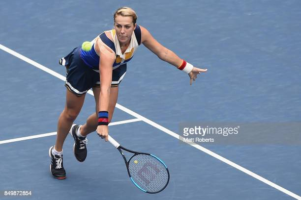Anastasia Pavlyuchenkova of Russia plays a backhand against Qiang Wang of China during day three of the Toray Pan Pacific Open Tennis At Ariake...