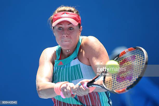 Anastasia Pavlyuchenkova of Russia plays a backhand in her first round match against Lauren Davis of the United States during day one of the 2016...