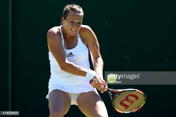 Anastasia Pavlyuchenkova of Russia plays a backhand in her Ladies Singles first round match against Mona Barthel of Germany during day two of the...