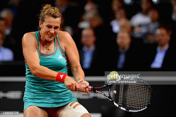 Anastasia Pavlyuchenkova of Russia plays a backhand in her match against Julia Goerges of Germany during day two of the WTA Porsche Tennis Grand Prix...