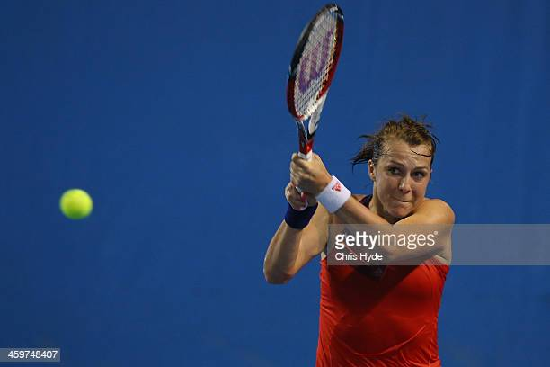 Anastasia Pavlyuchenkova of Russia plays a backhand in her match against Alla Kudryavtseva of Russia during day two of the 2014 Brisbane...