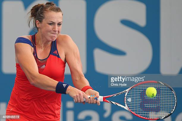 Anastasia Pavlyuchenkova of Russia plays a backhand in her match against Angelique Kerber of Germany during day four of the 2014 Brisbane...