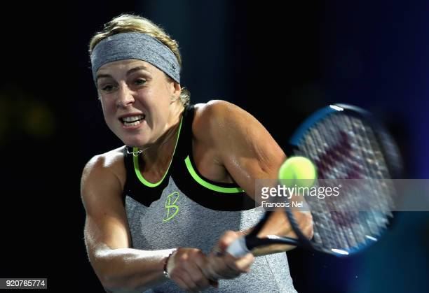 Anastasia Pavlyuchenkova of Russia plays a backhand in her match against Johanna Konta of Great Britain during day one of the WTA Dubai Duty Free...