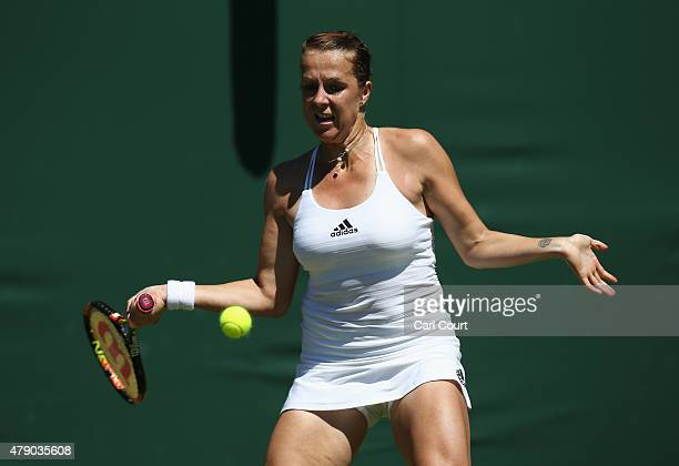Anastasia Pavlyuchenkova of Russia plays a forehand in her Ladies Singles first round match against Mona Barthel of Germany during day two of the...