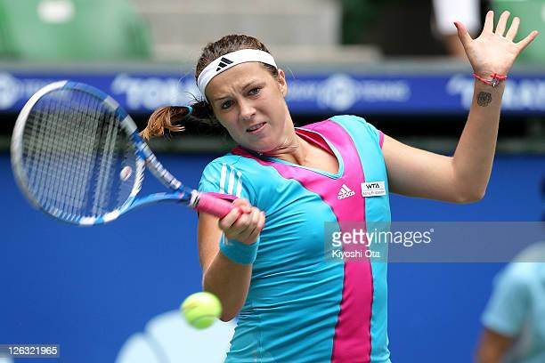 Anastasia Pavlyuchenkova of Russia plays a forehand in her match against Arantxa Rus of the Netherlands during the day one of the Toray Pan Pacific...