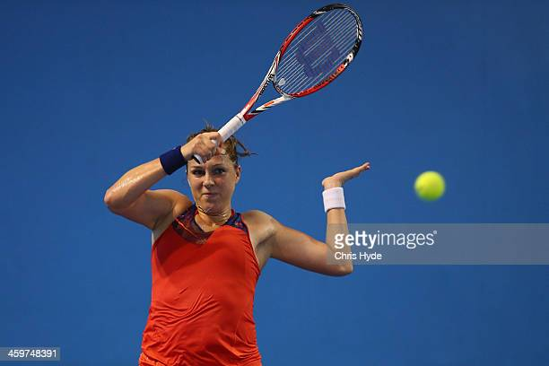 Anastasia Pavlyuchenkova of Russia plays a forehand in her match against Alla Kudryavtseva of Russia during day two of the 2014 Brisbane...