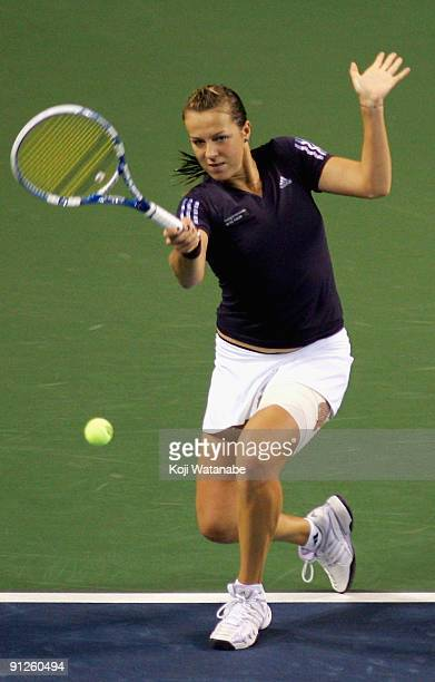 Anastasia Pavlyuchenkova of Russia plays a forehand in her match against Marion Bartoli of France during day four of the Toray Pan Pacific Open...