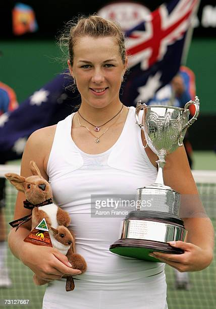 Anastasia Pavlyuchenkova of Russia poses with the trophy after winning her final juniors match against Madison Brengle of the USA on day thirteen of...