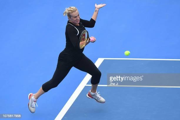 Anastasia Pavlyuchenkova of Russia returns a shot against Ana Bogdan of Romania during the women's singles 1st Round match on main draw day 1 of the...