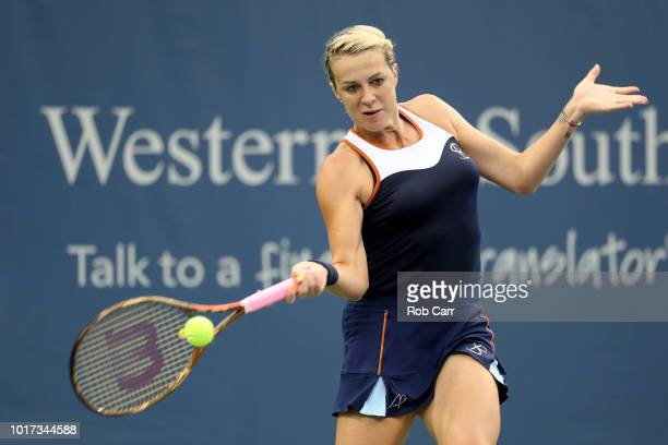 Anastasia Pavlyuchenkova of Russia returns a shot to Angelique Kerber of Germany during Day 5 of the Western and Southern Open at the Lindner Family...